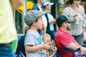 Bennet Soricelli enjoys a piece of candy as he watches last year's Berthoud Day Parade floats go by on Mountain Avenue. This year marks the 61st annual event that kicks off the summer season. Surveyor file photo