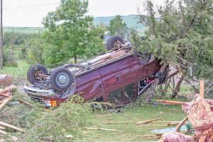 The storm's 140 mile per hour winds flipped vehicles like toy cars, like this one pictured in the Eyl's driveway on Blue Mountain Avenue.  Becky Justice-Hemmann / The Surveyor