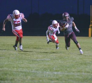 Berthoud High School graduate, Michael (Micol) Woodiel competes in a football game at BHS on Sept. 5, 2014.  Surveyor file photo