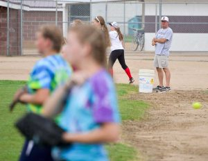 First year softball head coach Buddy Kouns watches as more than 30 girls practice at Bein Field at Berthoud High School on Aug. 18. Kouns may be new to the top spot in Spartans softball but he's been, and remains, Berthoud's baseball coach. Kouns said that this year there is a lot of interest for the team and the amount of girls who've come out for a spot on the team is higher than it's been in years. John Gardner / The Surveyor