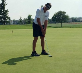 Berthoud's Shawn Solem putts during the Aug. 24 round at Ute Creek Golf Course in Longmont.  Dan Karpiel / The Surveyor