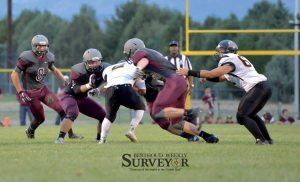 Berthoud's defense including Steele Castles, center, Karsten Bump, and Jamie Gray stop Valley running back Juan Gomez, as free safety Max Bump assists during the first half of the Sept. 4 game at Max Marr Field.  John Gardner / The Surveyor