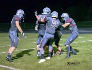 Berthouds Ben Douglas is congratulated by teammates after intercepting a blocked pass in the end zone for a touchdown vs. Fort Morgan on Sept. 18. John Gardner / The Surveyor