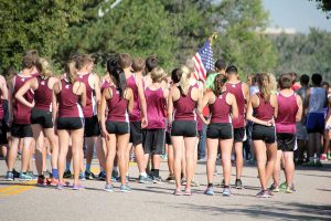 Berthoud Spartans paused to pay tribute to those involved in the events on 9/11/2001 before the start of the Liberty Bell Invitational. The boys team placed second and 18 Spartans set personal records at the meet. Photos courtesy of John Marquardt