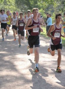 Working as a pack, Zac Marquardt, Josh Doyle and Murphy Vogele-Zimmerling race through the first mile in the Liberty Bell Invite last Friday. Photos courtesy of John Marquardt