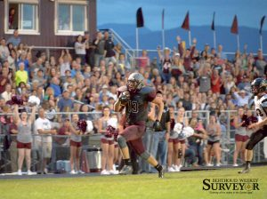Berthoud tight end Mccallan Castles runs unopposed for a 55-yard touchdown in the first quarter of the Spartans' season opener at Max Marr Field at Berthoud High School on Sept. 4. Castles, a sophomore, ended the night with three receptions for 85 yards and a touchdown. John Gardner / The Surveyor