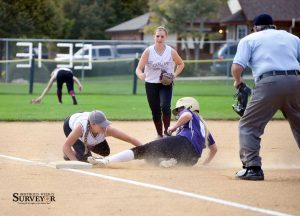 Berthoud third baseman Lindsay Erickson tags out Holy Family's Skylar Gardner at third base during the final regular season game at Bein Field on Oct. 8. The Spartans begin Regionals this Saturday. John Gardner / The Surveyor