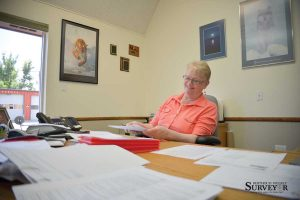 Berthoud Town Clerk Mary Cowdin goes through some of the applications from people who applied to fill her position after she retires at the end of the year. Cowdin has been town clerk for 22 years, and has worked for the Town of Berthoud for 32. John Gardner / The Surveyor