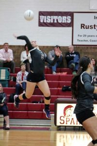 Berthoud's Julie Ward jumps for the ball in the Spartans' match versus Holy Family Tuesday night at Berthoud High School.  Paula Megenhardt / The Surveyor