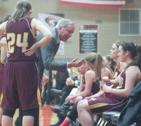 Berthoud girls basketball head coach Randy Earl speaks to his team during a break in the game against Erie last season. The Spartans return a core group of experienced players that will benefit the team this season. Surveyor file photo