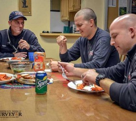 Berthoud Fire Protection District Captain Andrew Kuiken, left, and fellow firefighters Andy Burger, center, and Danny Reese enjoy a dinner at the firehouse. Spending the holidays on-call is just part of the job for first responders. John Gardner / The Surveyor