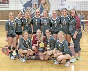 The Berthoud Volleyball team poses for a photo after winning the Class 4A Region 11 tournament and punching their ticket to the state tournament in Denver, starting Nov. 13 at the Denver Coliseum.  Paula Megenhardt / The Surveyor