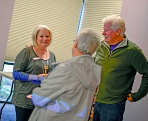 Berthoud Community Library Director Sara Wright speaks with friends at a farewell party at the library on Dec. 8. Many people stopped by to say farewell to the longtime director. John Gardner / The Surveyor