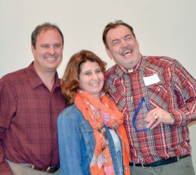 Brick Oven Pizza and Subs owner, Cliff Montano, right, received his Citizen of the Year award from Dave and Julia Sabados at the Berthoud Area Chamber of Commerce Annual Instalation Dinner on Jan. 23. The Sabadoses received the award the previous year. Becky Justice-Hemmann / The Surveyor