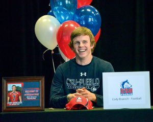 Berthoud High School senior and quarterback Cody Braesch is all smiles right before signing his letter of intent to play football at Colorado State University — Pueblo. Braesch along with four teammates signed letters to play in college next fall. It was the most athletes the school has had sign for football in school history. John Gardner / The Surveyor