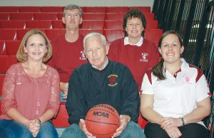 A basketball family tradition, started by John Beck (center) in the 1950s, continues today at Berthoud High School. John's daughters, Kellie Diffendaffer (left) and Teresa Rimsky (upper right) both played basketball at BHS along with Teresa's husband, Paul (top left). His granddaughter, Tara Olivas, was a player and is now an assistant coach at BHS. Photo by Angie Purdy / The Surveyor