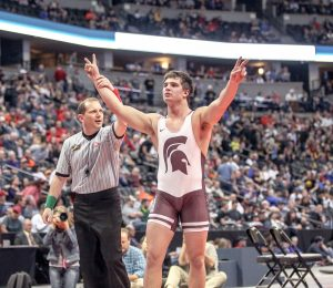 Chad Ellis celebrates his hard-fought victory in the 195-pound Class 3A wrestling championship at Pepsi Center in Denver on Feb. 20.  Karen Fate / The Surveyor