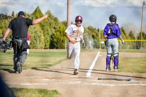 Berthoud's Chris DeSousa crosses home plate during the second inning of Tuesday's game versus Holy Family. The Spartans won the contest 10-5 to give them their second win of the season.  John Gardner / The Surveyor