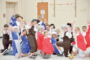 Ivy Stockwell fi fth grade teacher Jason Hooker, center, is surrounded by his class during a reenactment of the writing of the Constitution on Constitution Day in 2015. Surveyor file photo