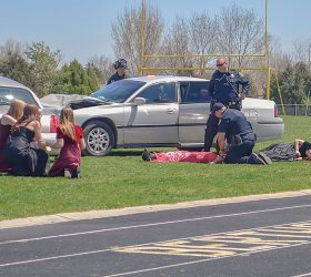 Berthoud students and fi rst responders act out a crash scene at Max Marr Field at Berthoud High School on Friday, April 22 in a mock drinking and driving event aimed at teaching students the perils of drinking and driving. May Soricelli / The Surveyor