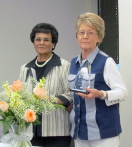 Marie Vigil and Elnora McCloughan display their Older Americans Month Awards. The Larimer County Office on Aging presented a cake to Vigil and McCloughan at their recognition on May 12. Bob McDonnell / The Surveyor