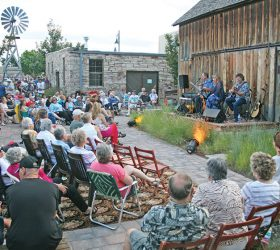 Patrons enjoy music in the courtyard at the Little Thompson Valley Pioneer Museum at one of the summer concert series. The series has three shows left this year. Photo courtesy of the Berthoud Historical Society