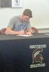 Berthoud High School graduate Patrick Barron signs his letter of intent, to play baseball at York College in Nebraska, at Berthoud High School last week. Courtesy photo
