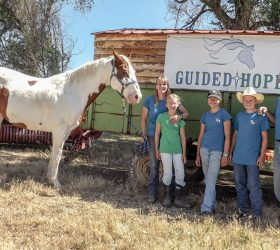 Guy and Kaarin Scoma, founders of Guided Hope in west Berthoud, run the nonprofit working ranch that helps people dealing with grief and loss or other issues. Guy and Kaarin operate the ranch with the help of their four children. From left to right, Scout the horse, Kaarin Scoma, Jessica, 10, Kira, 12, Tucker, 14, and Guy Scoma. The Scomas also have a 20-year-old daughter, Katelyn, who isn't pictured. photo by Katie Harris / The Surveyor