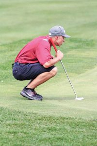 Berthoud's Jack Hummel lines up a putt during Tuesday's round at Ute Creek golf course in Longmont.