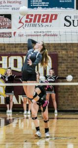 Julie Ward goes up for a kill against Windsor at Berthoud High School on Sept. 13.  Paula Megenhardt / The Surveyor