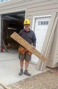 Habitat for Humanity volunteer Larry Jones helps get the homes ready for dedication next January. Katie Harris / The Surveyor