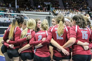 The Berthoud Spartans volleyball team gets a pep-talk from head coach Daisha Agho during the contest with Lewis-Palmer in the first round of the 4A state volleyball tournament on Nov. 11 at the Denver Coliseum. Paula Megenhardt / The Surveyor