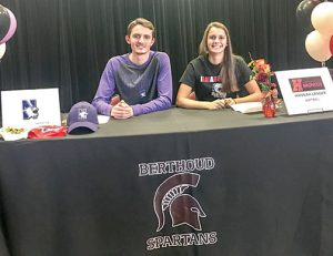 Berthoud High School students Liam Gately, left, and Hannah Langer, right, signed their letters of intent at BHS on Tuesday. Gately committed to Northwestern University for swimming while Langer committed Hastings College in Nebraska for softball. Dan Karpiel / the Surveyor