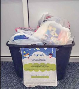 A bin for the Olson's Pajama Project overfl ows with donations at a local school shows the community's generosity. Courtesy photo