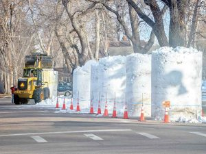Volunteers work to construct the large snow blocks that will be used in the Snow Sculpting Competition Thursday through Saturday. The event is the anchor to the inaugural Berthoud Snowfest that also includes the annual Parade of Lights Saturday night along Mountain Avenue. Berthoud Weekly Surveyor photo